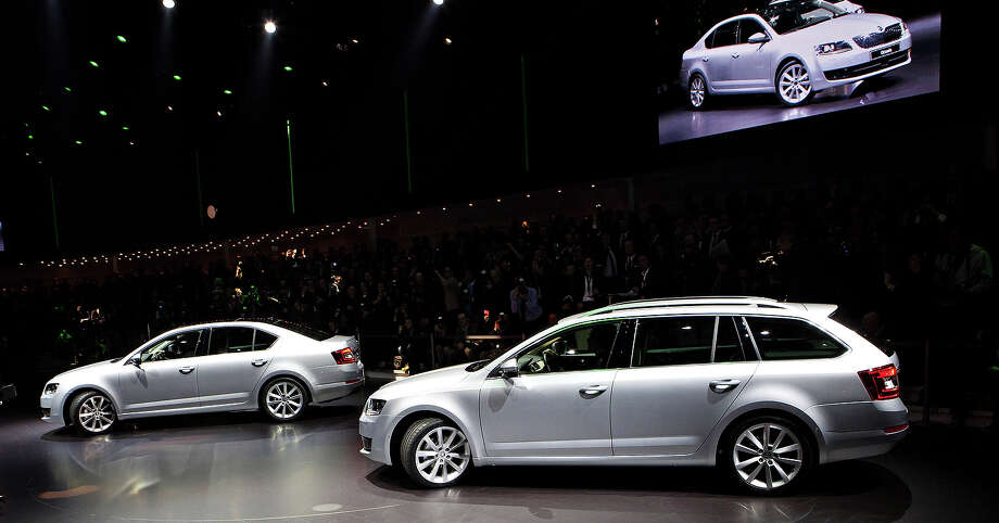 Czech car maker Skoda Auto presents the world premiere of the new Skoda Octavia Combi car during VW Group night for the media at the Geneva Motor Show on March 4, 2013 in Geneva, Switzerland. Skoda is a subsidiary of the Volkswagen Group. Photo: Isifa, Getty Images / 2013 isifa