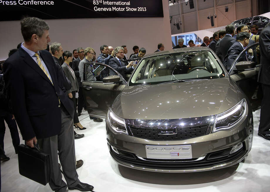 A Qoros 3 Sedan is displayed as an European premiere at the Chinese car maker's booth during the 83rd Geneva Motor Show on March 5, 2013 in Geneva. The Geneva International Motor Show opens its doors under a dark cloud, with no sign of a speedy rebound in sight for the troubled European market. Photo: FABRICE COFFRINI, AFP/Getty Images / 2013 AFP