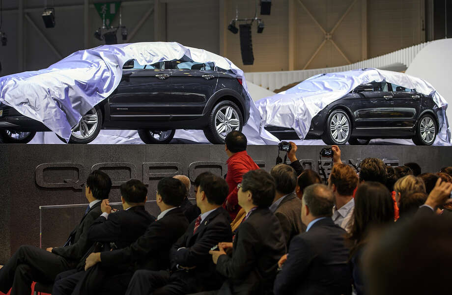 Two concept cars are unveilled at the booth of Chinese car maker Qoros during the 83rd Geneva Motor Show on March 5, 2013 in Geneva. The Geneva International Motor Show opens its doors under a dark cloud, with no sign of a speedy rebound in sight for the troubled European market. Photo: FABRICE COFFRINI, AFP/Getty Images / 2013 AFP