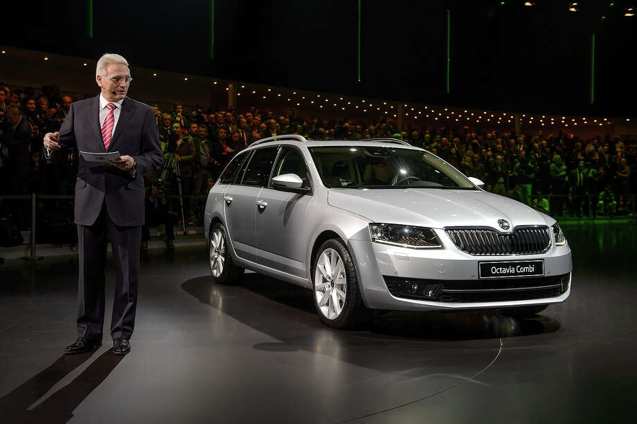 Skoda Chairman Winfried Vahland presents a Skoda Octavia Combi model car during a preview of German car maker Volkswagen Group on March 4, 2013 ahead of the Geneva Car Show in Geneva. Photo: FABRICE COFFRINI, AFP/Getty Images / 2013 AFP