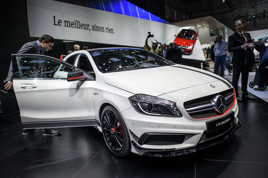 The new Mercedes Benz A 45 AMG edition is displayed in World Premiere at the German car maker's booth during the 83rd Geneva Motor Show on March 5, 2013 in Geneva. The Geneva International Motor Show opened its doors to the press under a dark cloud, with no sign of a speedy rebound in sight for the troubled European market. The event, which is considered one of the most important car shows of the year, will again be heavily marked by the crisis in Europe after an already catastrophic year in 2012. Photo: FABRICE COFFRINI, AFP/Getty Images / 2013 AFP