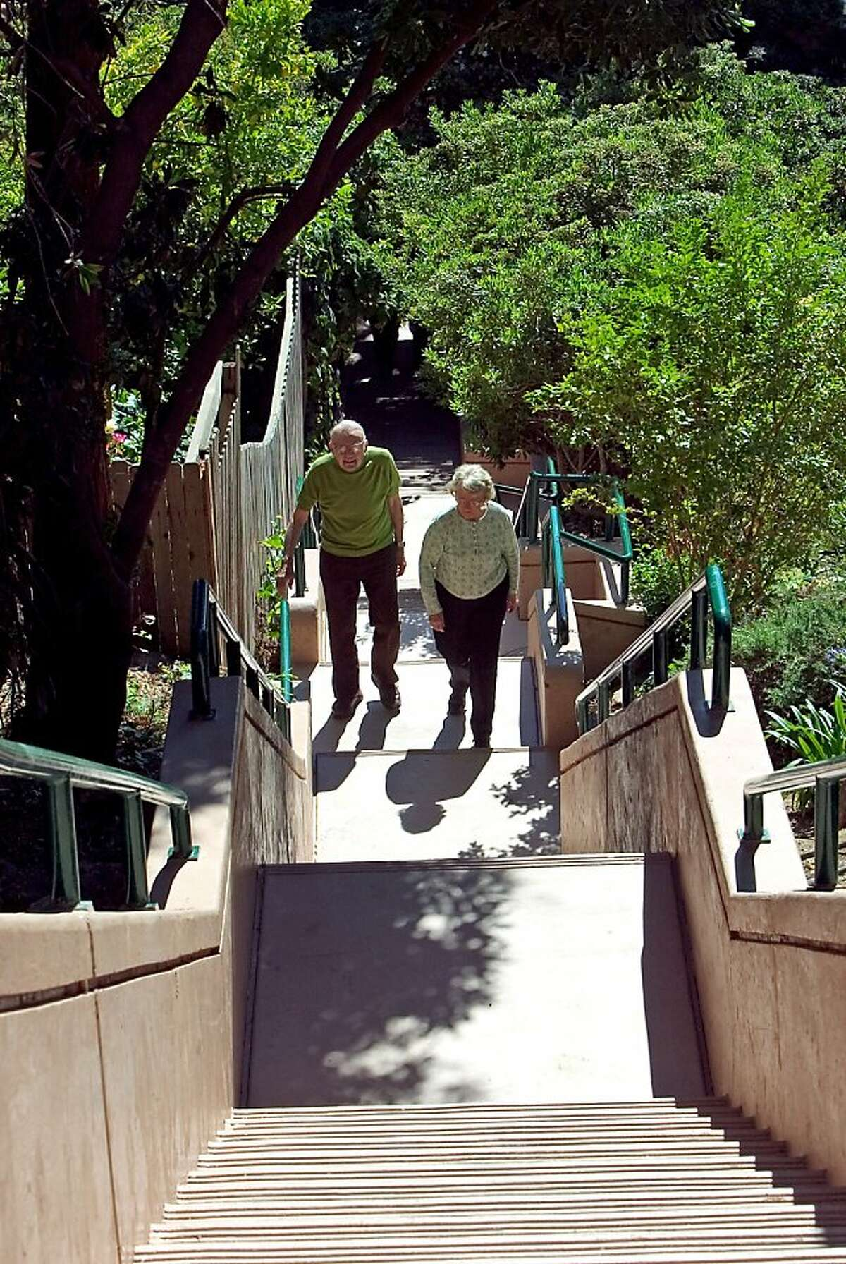 A file photo of local residents walking the Oakmore stairs in the Oakmore district of Oakland.