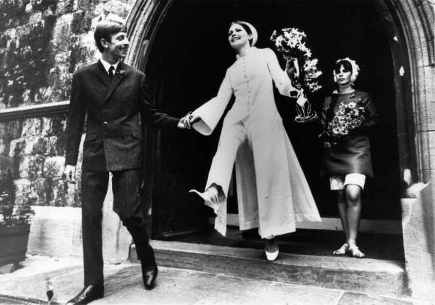 1966: Fashion model, Carol Chilvers, and fashion photographer, Frank Sweeney, on their weddin