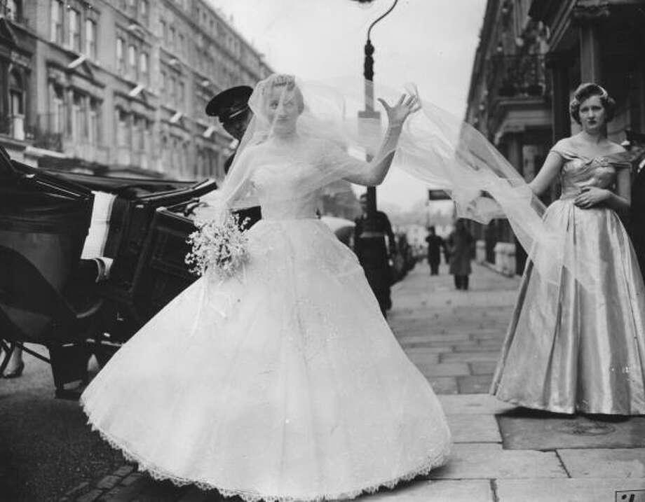 1957:Miss Janice Pike leaving Kensington Palace Hotel  Photo: Folb, Getty / Hulton Archive