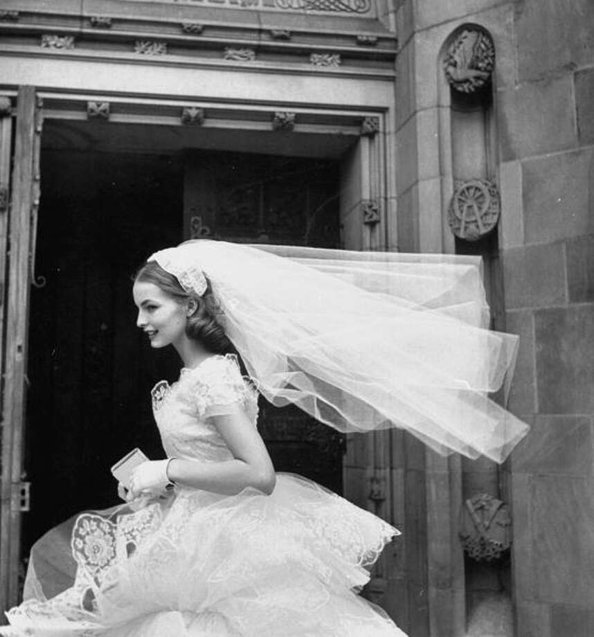 1952:Martha Boss, the country's top bridal model is wearing a nylon tulle lace gown and veil. Photo: Leonard McCombe, Getty / Leonard Mccombe