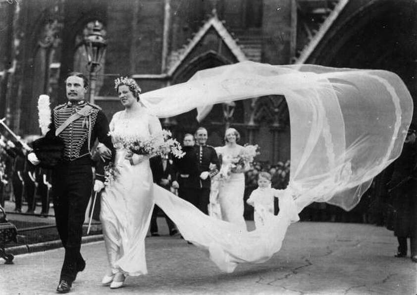 1935: A boisterous gust of wind catches the bridal veil