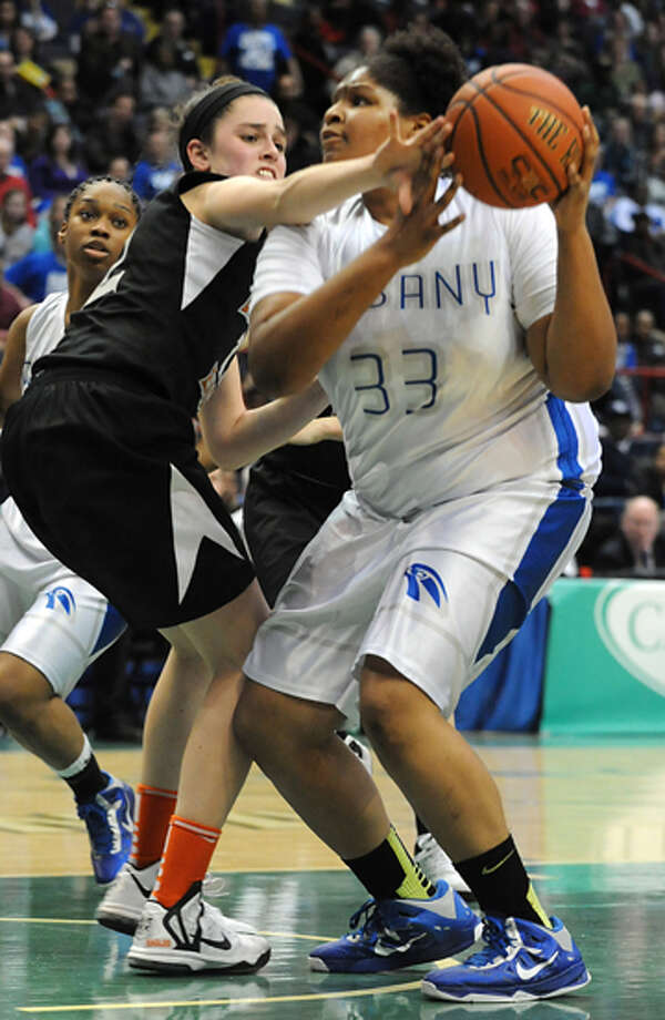 Albany's Melissa Canty drives to the basket against Bethlehem's Jenna Giacone during the Class AA girls' championship basketball game at the Times Union Center on Monday March 4, 2013 in Albany, N.Y. Photo: Lori Van Buren
