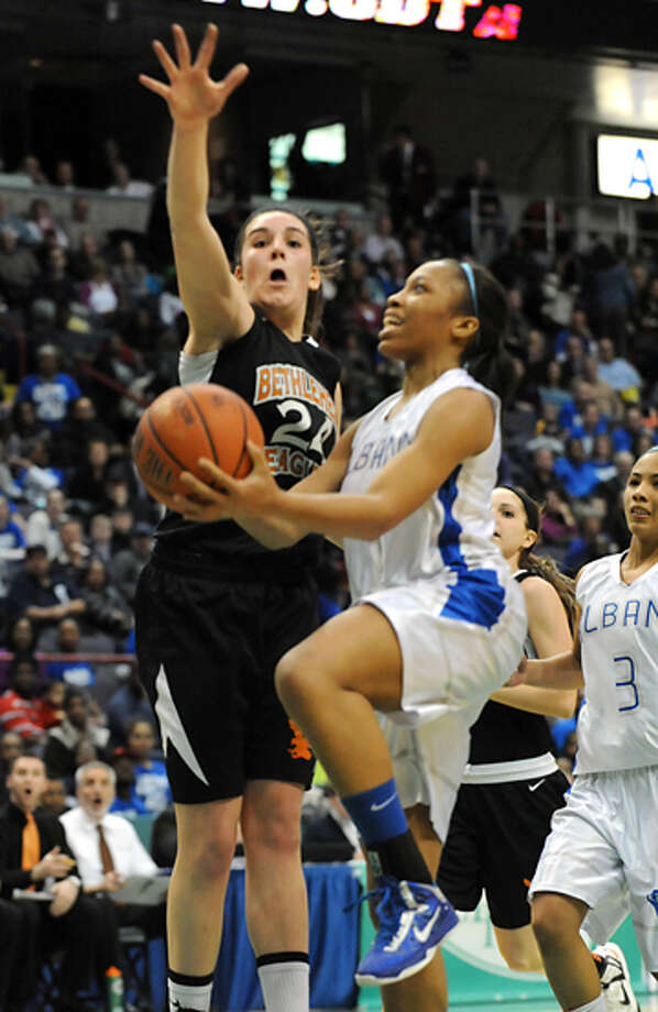 Albany's Emia Willingham-Hurst drives to the basket against Bethlehem's Gabby Giacone during the Class AA girls' championship basketball game at the Times Union Center on Monday March 4, 2013 in Albany, N.Y. Photo: Lori Van Buren