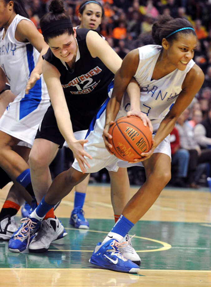 Bethlehem's Jenna Giacone battles for the ball with Albany's Mylah Chandler during the Class AA girls' championship basketball game at the Times Union Center on Monday March 4, 2013 in Albany, N.Y. Photo: Lori Van Buren