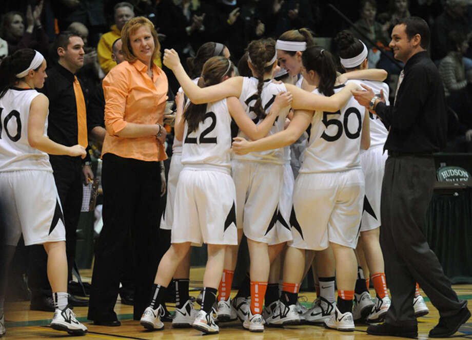 Bethlehem celebrates after defeating Colonie in their Section II Class AA girl's basketball semifinal game on Wednesday Feb. 27, 2013 in Troy, N.Y. Photo: Michael P. Farrell