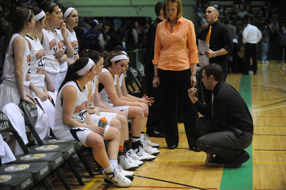 Bethlehem head coach Matthew Bixby, right, talks with his team during their Section II Class AA girl's basketball semifinal game against Colonie on Wednesday Feb. 27, 2013 in Troy, N.Y. Photo: Michael P. Farrell