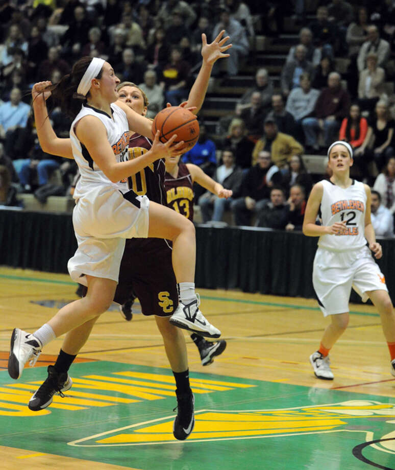 Bethlehem's Kaylee Rickert  goes in for a score during their Section II Class AA girl's basketball semifinal game against Colonie on Wednesday Feb. 27, 2013 in Troy, N.Y. Photo: Michael P. Farrell