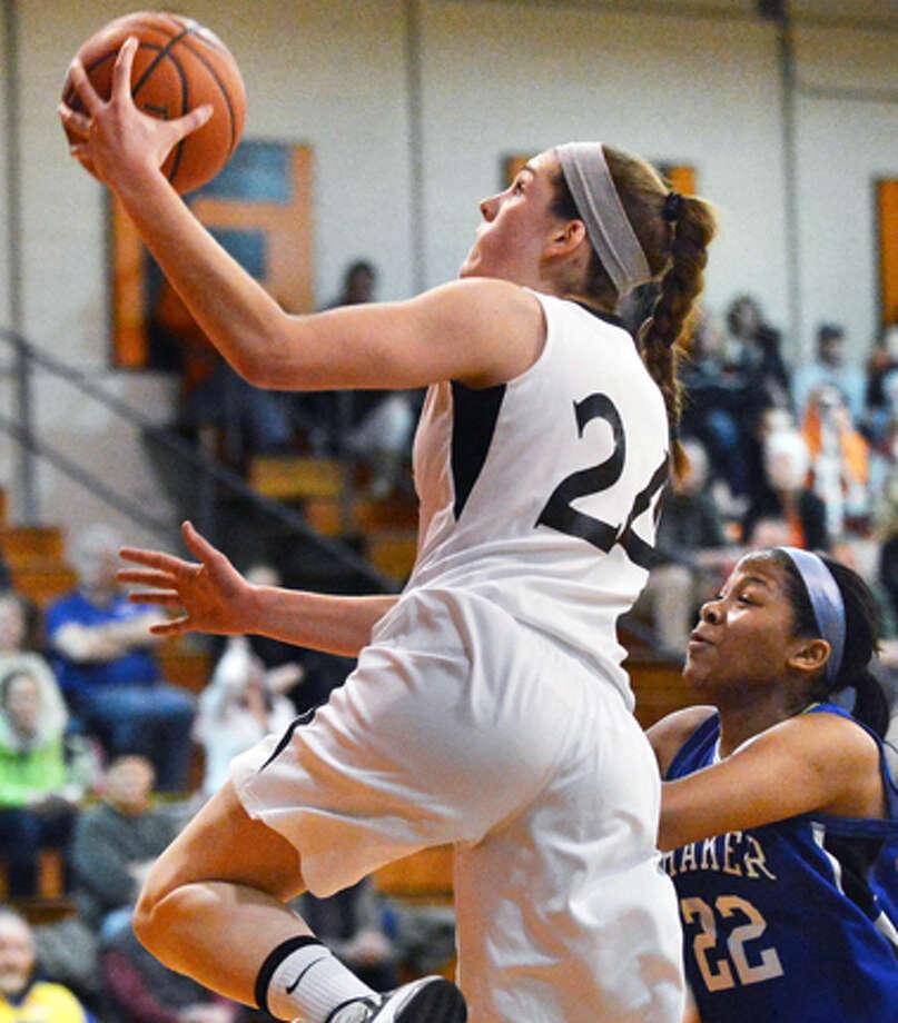 Bethlehem's #24 Gabby Giacone goes for two in Friday's game against Shaker at Bethlehem High Jan. 25, 2013. Photo: John Carl D'Annibale