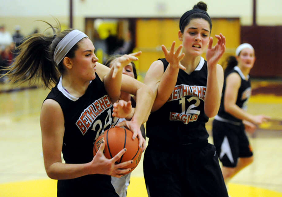 Bethlehem's Gabby Giacone (24), left, and her sister Jenna Giacone (12), right, battle for a loose ball with Colonie's Kelly Lane (25), center, during their basketball on Friday, Dec. 14, 2012, at Colonie High in Colonie, N.Y. Photo: Cindy Schultz