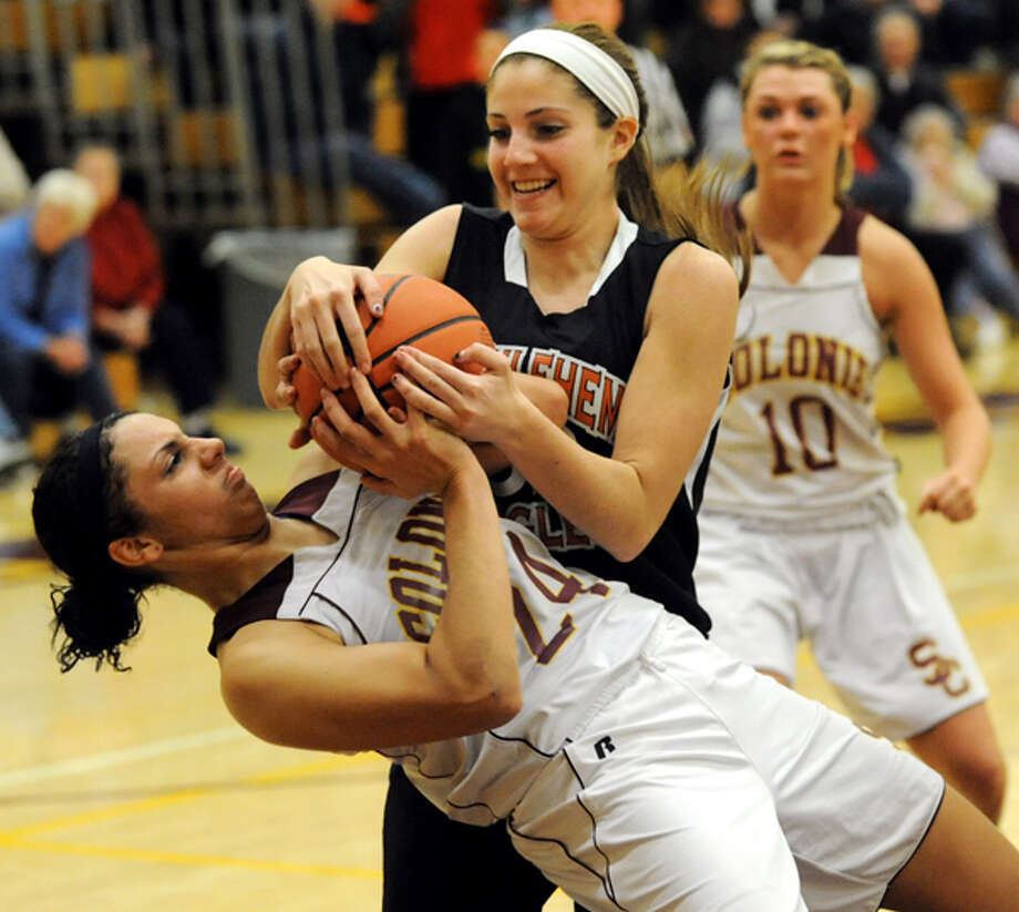 Colonie's Sydnie Rosales (24), left, and Bethlehem's Olivia Hughes (32), center, battle for the ball during their basketball on Friday, Dec. 14, 2012, at Colonie High in Colonie, N.Y. Photo: Cindy Schultz