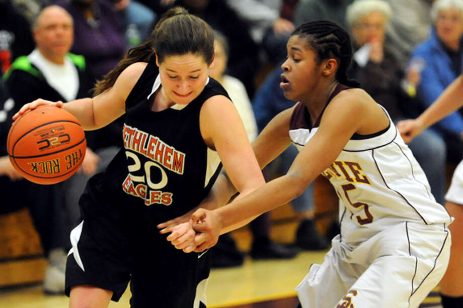 Bethlehem's Bridget Murphy (20), left, controls the ball as Colonie's Nicole Riddick (15) defends during their basketball on Friday, Dec. 14, 2012, at Colonie High in Colonie, N.Y. Photo: Cindy Schultz