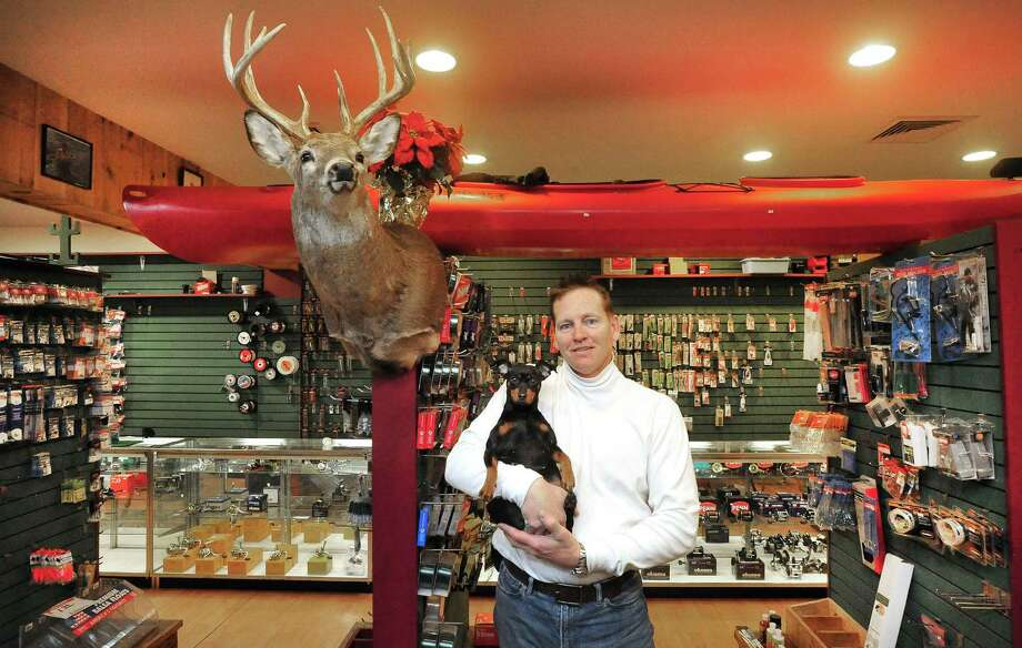 David Tressic holds Gracie at The Valley Angler in Danbury, Conn. Monday, March 4, 2013. Photo: Michael Duffy / The News-Times