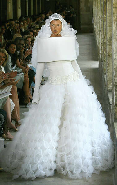 2003-2004: A model presents a wedding dress by German fashion designer Karl Lagerfeld