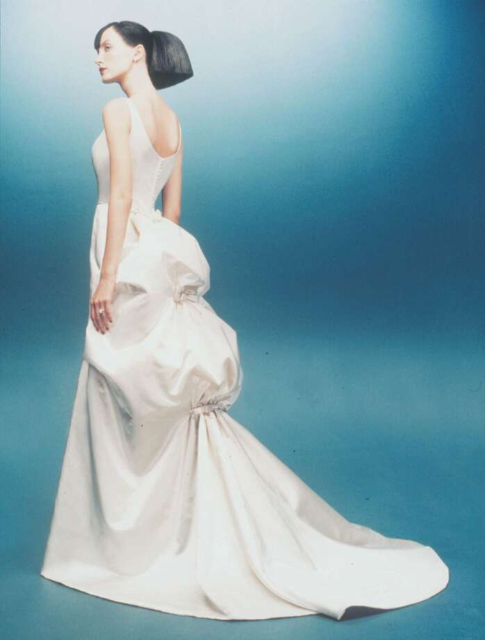 2000: A glamorous wedding dress by Amsale is a smooth sculptured sweep of silk zibalene with a deep-cut backline.  Photo: AP/Getty / AMSALE