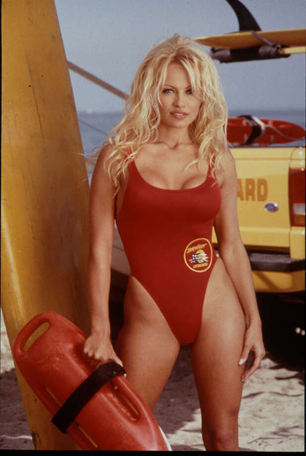 Pamela Anderson, another former playmate (Miss February 1990), became a household name after six years in a red swimsuit as lifeguard C.J. Parker.  Photo: Unknown / Unknown