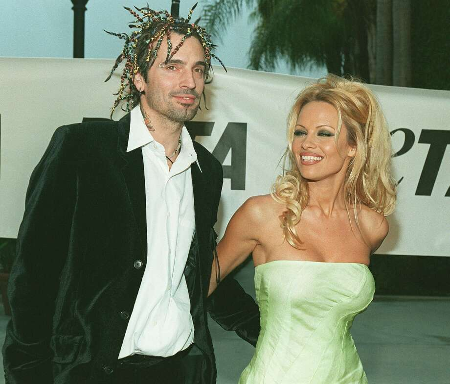 The show's credits had to reflect her name change to Pamela Lee after she married rocker Tommy Lee (the former couple is pictured here in September 1999). She went back to Anderson quite a while ago. / Getty Images