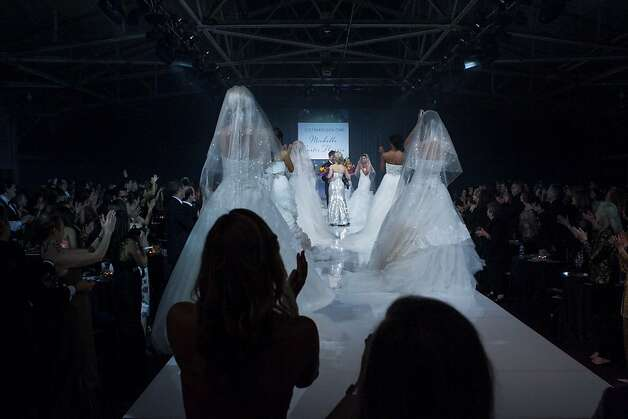 Models in wedding gowns walk the runway during the Junior League Fashion Show on March 1, 2013. Photo: Drew Altizer Photography
