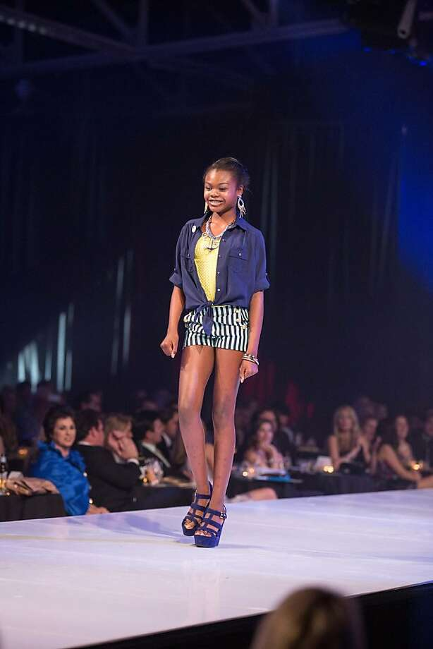 A model walks the runway during the Junior League Fashion Show on March 1, 2013. Photo: Drew Altizer Photography