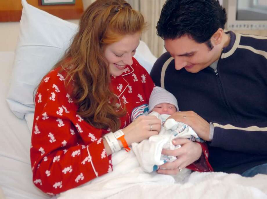"Greenwich, Jan. 1, 2009.  Sheri McGowan and her husband Taylor admire their newborn daughter, Lilliana Joy, 5 pounds, 14 ounces, and 19 1/2 "" long.  Lilliana is the first baby born in 2010 in Greenwich Hospital.  The family lives in Norwalk. Photo: Helen Neafsey / Greenwich Time"