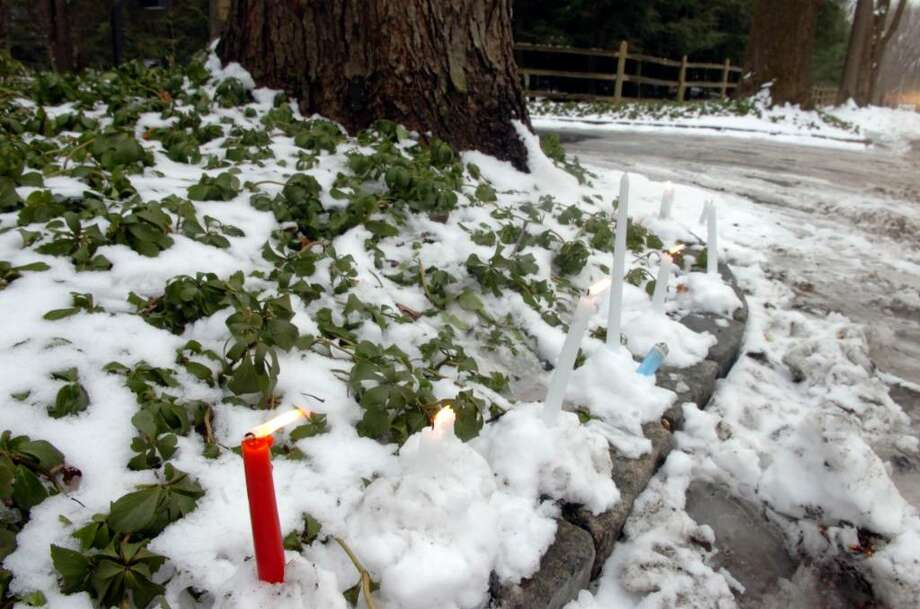 Greenwich, Jan. 1, 2010.  Candles lit near the driveway of 100 Sterling Road in memory of Amanda Dobrzanski, the young woman who was killed there on Dec. 30.  Her father Adam Dobrzanski has been charged with her death. Photo: Helen Neafsey / Greenwich Time