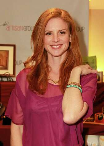 Actress Sarah Rafferty tried on the Charity Bracelets made by Jewels for Hope at the Oscar's Gift Lounge  at The Sofitel Los Angeles last month.