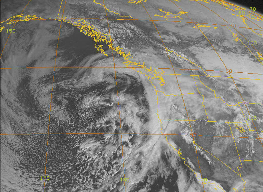 A satellite image of the West Coast Tuesday morning shows a storm front approaching the Bay Area. Photo: NOAA