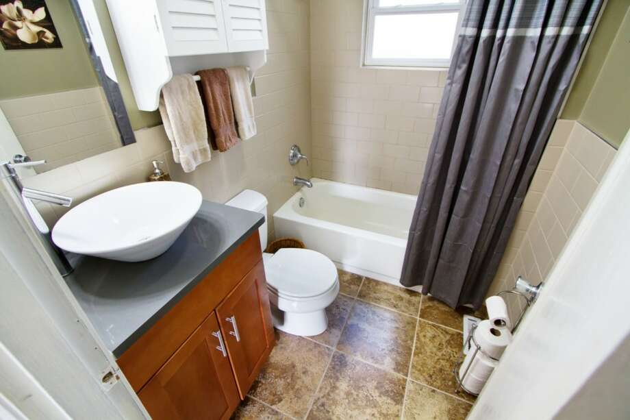 Bathroom of 11745 14th Ave. N.E. The 1,040-square-foot bungalow, built in 1945, has two bedrooms, one bathroom, an updated kitchen, a partially finished basement with a fireplace, a deck, a patio and a fire pit on a 6,217-square-foot lot. It's listed for $315,000. Photo: Courtesy Jesse Moore/Keller Williams Realty Bothell