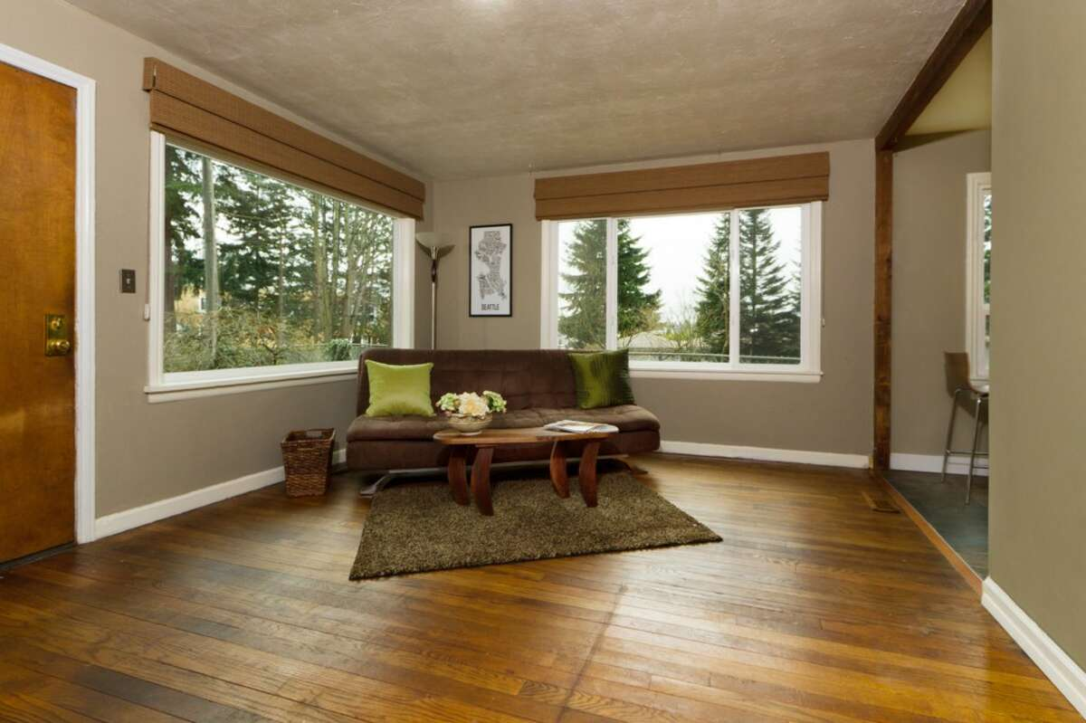 Living room of 11745 14th Ave. N.E. The 1,040-square-foot bungalow, built in 1945, has two bedrooms, one bathroom, an updated kitchen, a partially finished basement with a fireplace, a deck, a patio and a fire pit on a 6,217-square-foot lot. It's listed for $315,000.