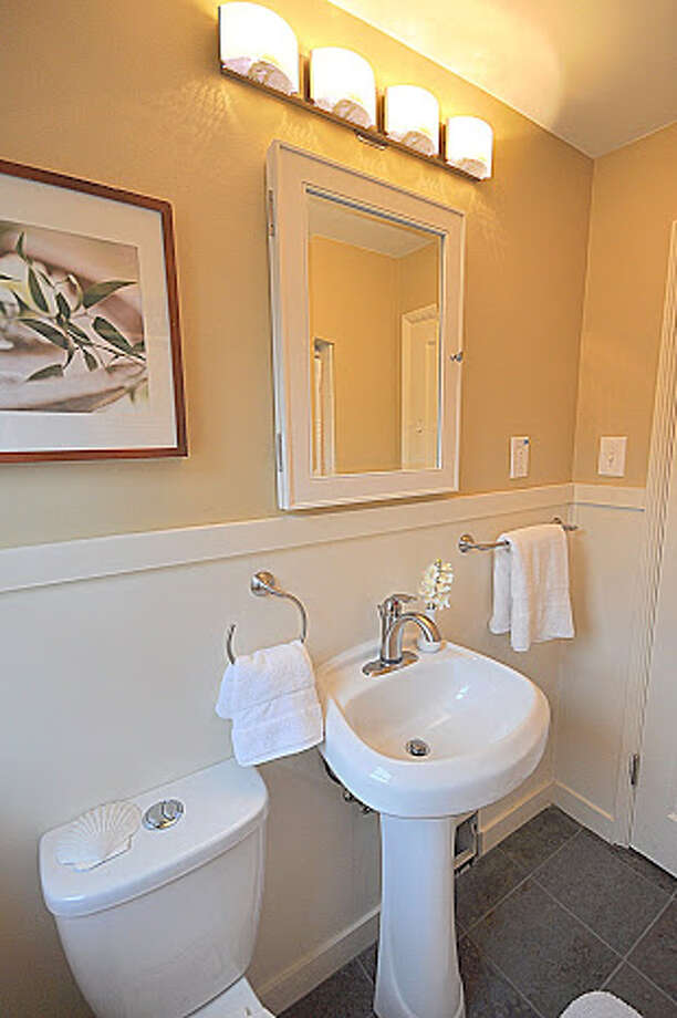 Bathroom of 830 N.E. 125th St. The 1,500-square-foot house, built in 1941, has three bedrooms, full and three-quarter bathrooms, exposed-wood moldings, an updated kitchen, a rec room and a patio on a 7,936-square-foot lot. It's listed for $389,000. Photo: Picasa, Courtesy Michael Bill And Scott Whaley/Windermere Real Estate