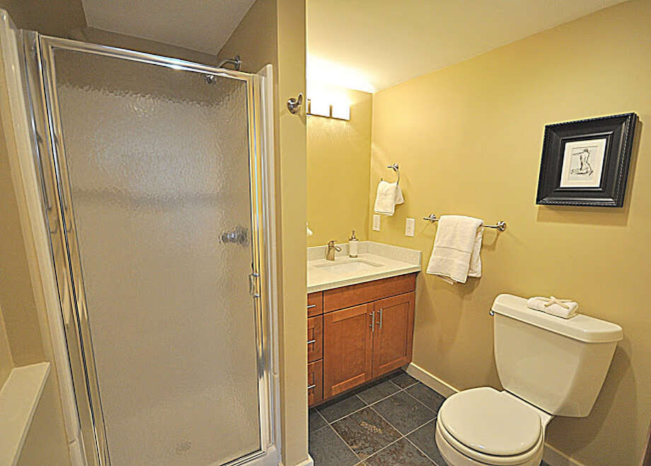 Three-quarter bathroom of 830 N.E. 125th St. The 1,500-square-foot house, built in 1941, has three bedrooms, full and three-quarter bathrooms, exposed-wood moldings, an updated kitchen, a rec room and a patio on a 7,936-square-foot lot. It's listed for $389,000. Photo: Picasa, Courtesy Michael Bill And Scott Whaley/Windermere Real Estate