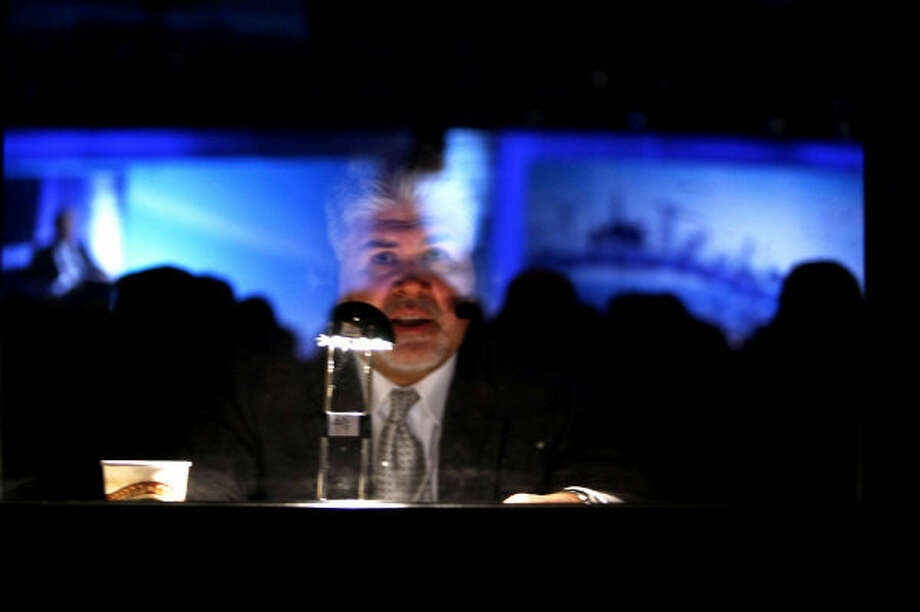 A man translates speakers at the IHS CERAWeek energy conference for international attendees.
