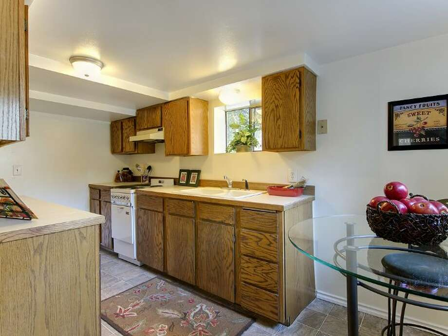 Mother-in-law apartment of 12516 14th Ave. N.E. The 2,320-square-foot house, built in 1942, has three bedrooms and two bathrooms, a front  deck and a two-car garage on a 9,042-square-foot lot. It's listed for $349,950, although a sale is pending. Photo: Courtesy Stefanie A. Massie And Laurie Vandermay/Windermere Real Estate
