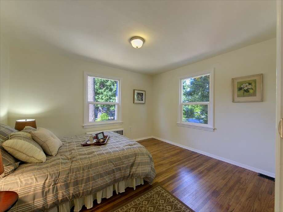Bedroom of 12516 14th Ave. N.E. The 2,320-square-foot house, built in 1942, has three bedrooms and two bathrooms -- including a mother-in-law apartment in the basement -- a front  deck and a two-car garage on a 9,042-square-foot lot. It's listed for $349,950, although a sale is pending. Photo: Courtesy Stefanie A. Massie And Laurie Vandermay/Windermere Real Estate
