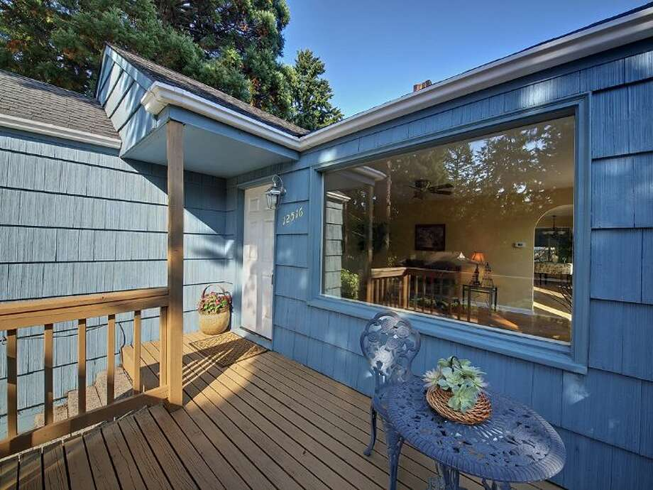 Front deck of 12516 14th Ave. N.E. The 2,320-square-foot house, built in 1942, has three bedrooms and two bathrooms -- including a mother-in-law apartment in the basement -- and a two-car garage on a 9,042-square-foot lot. It's listed for $349,950, although a sale is pending. Photo: Courtesy Stefanie A. Massie And Laurie Vandermay/Windermere Real Estate