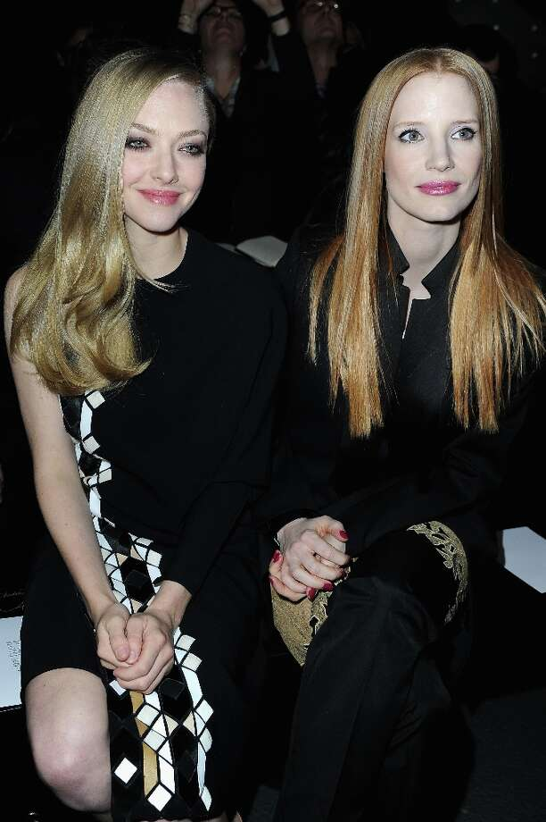 Amanda Seyfried and Jessica Chastain attend Givenchy  Fall/Winter 2013 Ready-to-Wear show as part of Paris Fashion Week on March 3, 2013 in Paris, France. Photo: Pascal Le Segretain, Getty Images / 2013 Getty Images