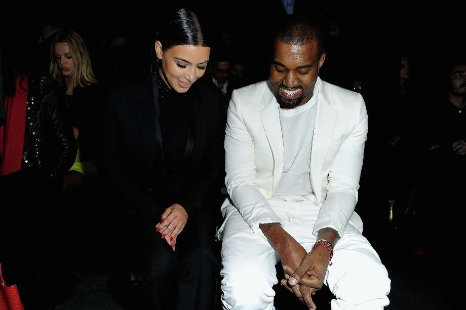 Kim Kardashian and Kanye West attend Givenchy  Fall/Winter 2013 Ready-to-Wear show as part of Paris Fashion Week on March 3, 2013 in Paris, France. Photo: Pascal Le Segretain, Getty Images / 2013 Getty Images