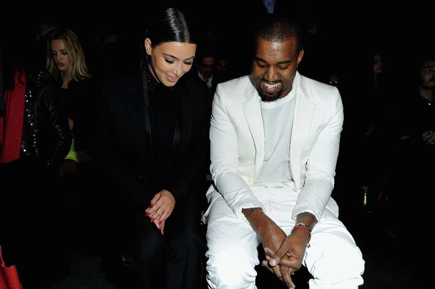 Kim Kardashian and Kanye West attend Givenchy  Fall/Winter 2013 Ready-to-Wear show as part of Paris