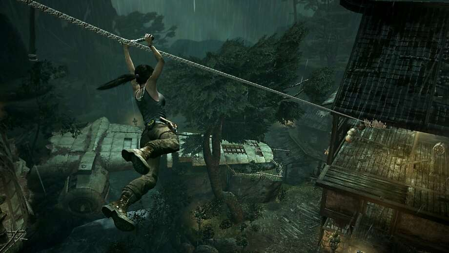 "Lara Croft finds herself isolated on a sinister island in the new version of ""Tomb Raider."" Photo: Associated Press"