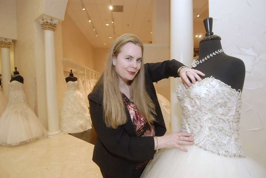 A.J. Ruley with one of the many dresses available at Weddings by Debbie 1/29/13. Photo by Tony Bullard. Photo:  Tony Bullard 2013, Freelance Photographer / © Tony Bullard & the Houston Chronicle