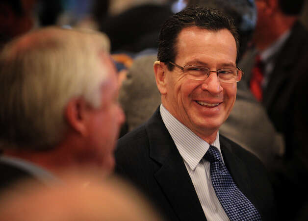 Governor Dannel P. Malloy, right, chats with Bridgeport Mayor Bill Finch during a Bridgeport Regional Business Council luncheon at the Holiday Inn in Bridgeport, Conn. on Tuesday, March 5, 2013. Photo: Brian A. Pounds / Connecticut Post