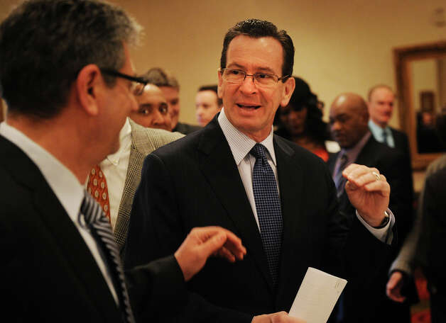 Mark Altieri, left, of Southern Connecticut Gas, Co., chats with Governor Dannel P. Malloy during a Bridgeport Regional Business Council luncheon at the Holiday Inn in Bridgeport, Conn. on Tuesday, March 5, 2013. Photo: Brian A. Pounds / Connecticut Post
