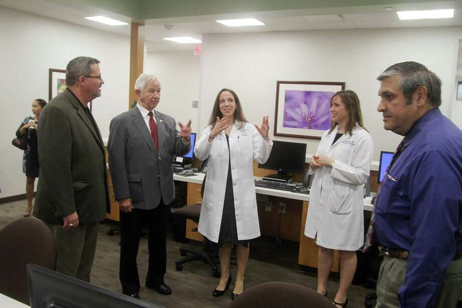 Arthur Velasquez, left, chief administrator for Brazoria County Judge Joe King, Pearland Mayor Tom Reid and County Commissioner Matt Sebesta, right, tour the new Texas Children's Pavilion for Women Obstetrics & Gynecology Pearland facility with the practice physicians, Dr. Beth Davis and Dr. Kelly Hodges.   Arthur Velasquez, left, chief administrator for Brazoria County Judge Joe King, Pearland Mayor Tom Reid and County Commissioner Matt Sebesta, right, tour the new Texas Children's Pavilion for Women Obstetrics & Gynecology Pearland facility with the practice physicians, Dr. Beth Davis and Dr. Kelly Hodges. Photo: Pin Lim, Freelance / Copyright Pin Lim.