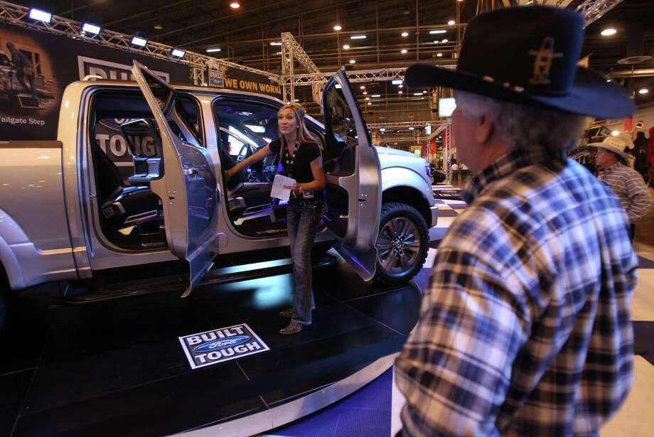 Kristen Garrett, Ford representative, gives details about the new Atlas, a concept Ford truck, to rodeo attendees at Reliant Center on Monday, March 4, 2013, in Houston.