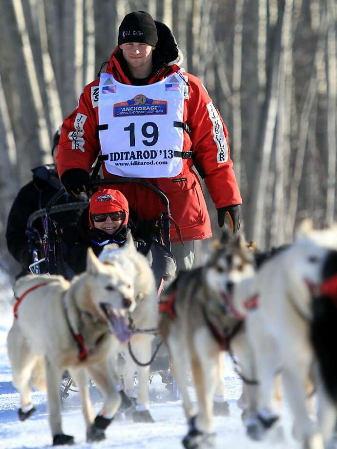 Dallas Seavey, 2012 Iditarod champion, drives his team during the ceremonial start of the Iditarod Trail Sled Dog Race Saturday, March 2, 2013, in Anchorage, Alaska. The competitive portion of the 1,000-mile race is scheduled to begin Sunday in Willow, Alaska. (AP Photo/Dan Joling) Photo: Dan Joling, Associated Press