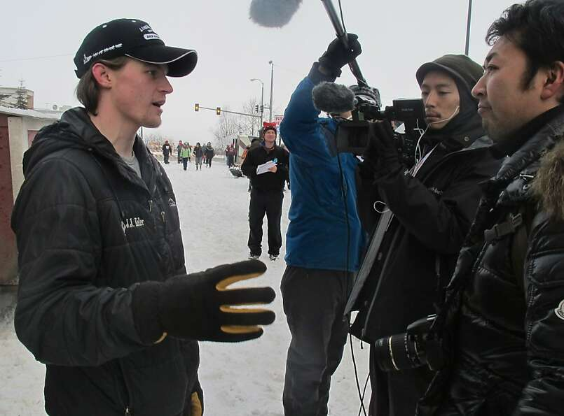 Defending champion Dallas Seavey, left, is interviewed by Japanese media before the ceremonial start